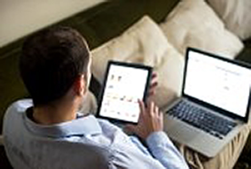 Man using multiple devices on home networking